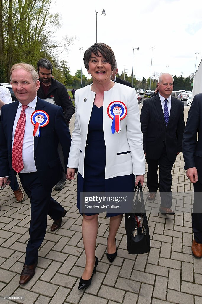 DUP leader Arlene Foster (C) is welcomed by party members as she arrives at the Northern Ireland Assembly elections count at Omagh Leisure on May 6, 2016 in Omagh, Northern Ireland. 276 candidates are contesting 108 seats across the province. The Democratic Unionist Party are predicted to return as the largest political party in the province with Arlene Foster also returned as First Minister of the power sharing government with Sinn Fein the second largest party.
