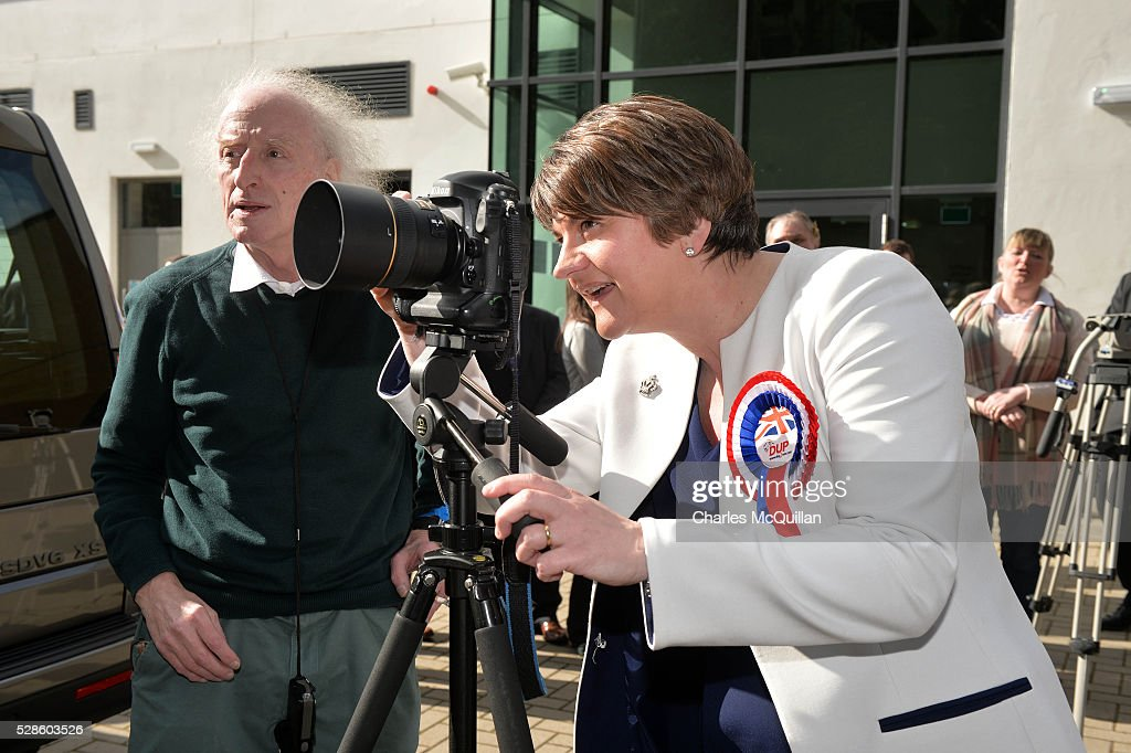 DUP leader Arlene Foster jokes as she attempts to take a photograph of a party colleague after being elected at the Northern Ireland Assembly count at Omagh Leisure on May 6, 2016 in Omagh, Northern Ireland. Two hundred and seventy six candidates are contesting 108 seats across the province. The Democratic Unionist Party are predicted to return as the largest political party in the province with Arlene Foster also returned as First Minister of the power sharing government with Sinn Fein the second largest party.