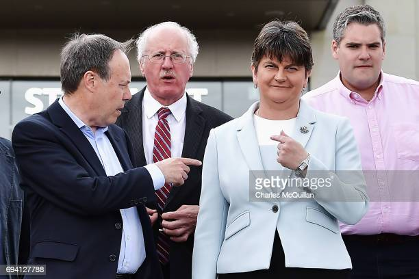 Leader Arlene Foster stands with DUP Deputy Leader Nigel Dodds and fellow DUP MP's after addressing the news of a possible Parliamentary agreement...