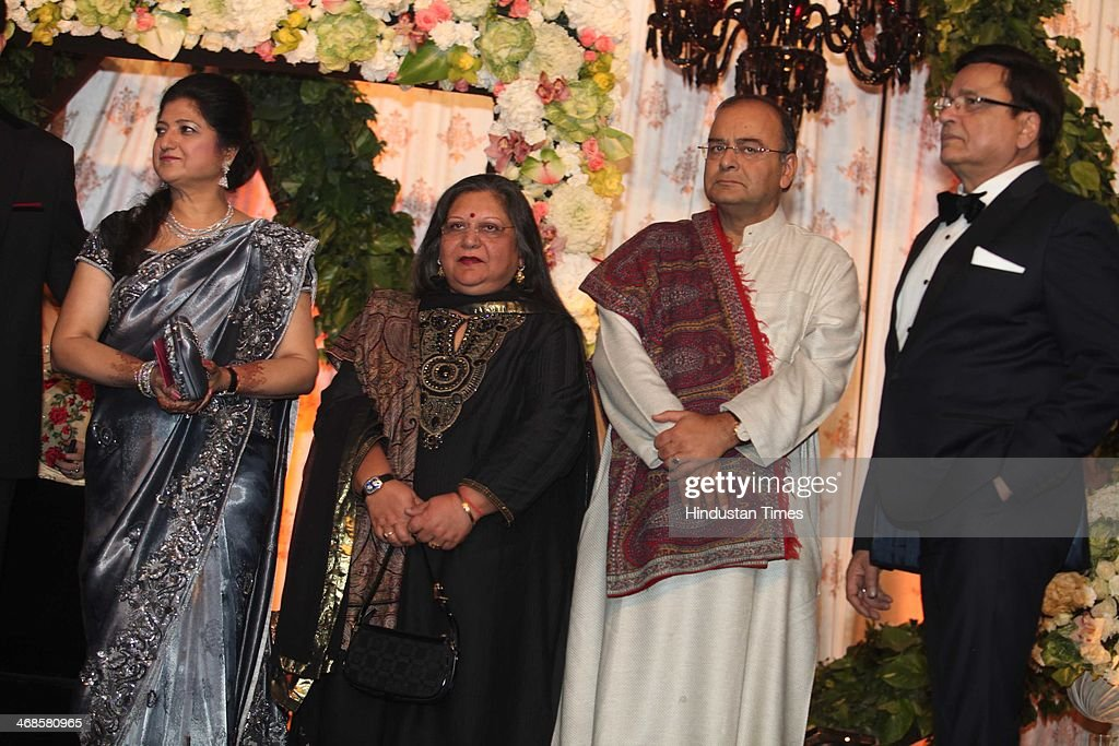 BJP leader Arun Jaitley (C R) and Sangeeta Jaitley (C L) during the wedding reception of Ahana Deol and Vaibhav Vohra on February 5, 2014 in New Delhi, India. Ahana, a budding Odissi dancer, is the daughter of Bollywood stars Dharmendra and Hema Malini while Vaibhav in an Indian businessman. They married on February 2, 2014 in Mumbai.