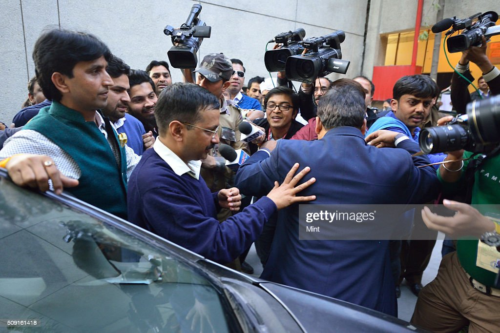 AAP leader Arvind Kejriwal arrives at counting centre at Gole Market for collecting his election victory certificate on February 10, 2015 in New Delhi, India.