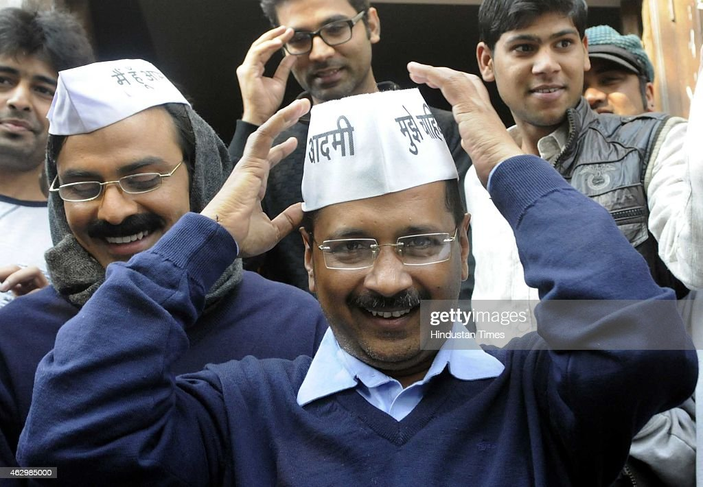 AAP leader Arvind Kejriwal with his look alike Jitendra Kumar, actor after programme recording at Kaushambi, Ghaziabad on February 8, 2015 in New Delhi, India. The former Delhi chief minister obliged his admirers and posed for pictures and selfies with them. According to exit polls, AAP appears set for a sweeping victory in the Delhi Assembly elections for which voting took place.