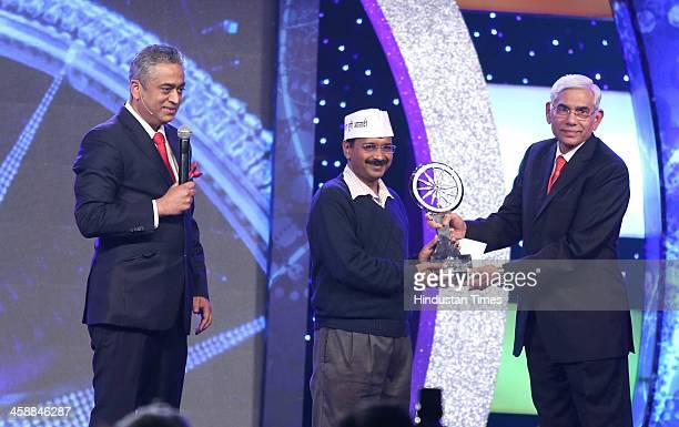 AAP leader Arvind Kejriwal with Vinod Rai and Rajdeep Sardesai EditorinChief of IBN18 Network during the CNNIBNs Indian of The Year 2013 Award on...