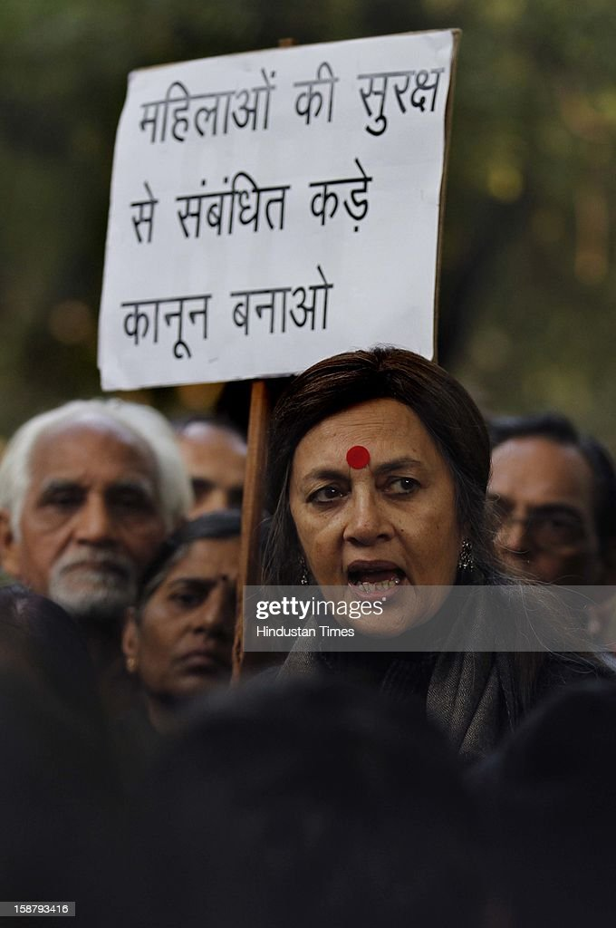 CPI Leader Brinda Karat paying homage the site of a protest to mourn the death of Rape victim girl at Jantar Mantar on December 29, 2012 in New Delhi, India. The nation was shocked in the morning after news of her death at the Singapore's Mount Elizabeth Hospital, where she was undergoing treatment. The Gang-rape of 23 year old girl in a moving bus enraged the entire country and galvanized people to demand for protection for women and justice for victims of such heinous crimes. There was heavy security deployment all around the city as many roads were blocked and metro stations were closed down to prevent any untoward incident.