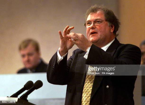 Leader Charles Kennedy listens to Digby Jones Director General of the Confereration of British Industry speaking at the Liberal Democrat Party's...