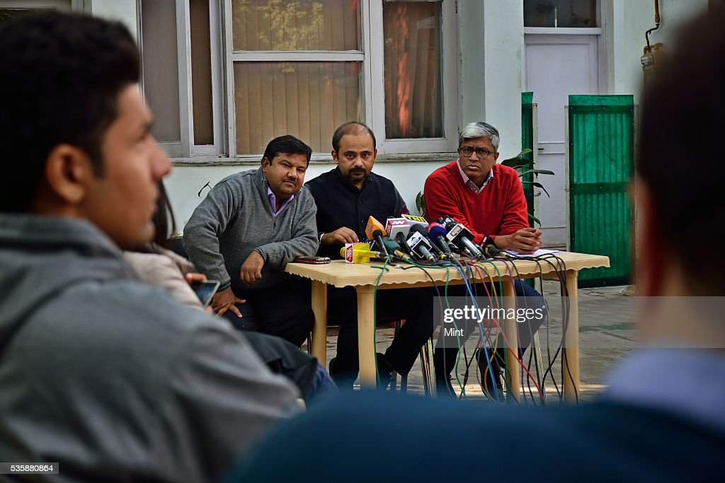 AAP leader Dilip Pandey (centre) and Ashutosh (extreme right) address a press conference on December 28, 2015 in New Delhi, India.