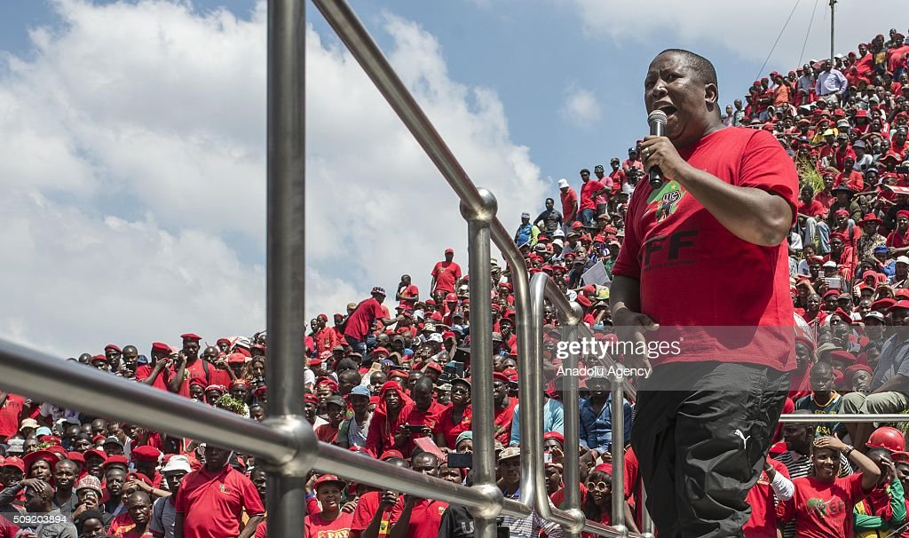 EFF leader Julius Malema addresses the crowd as thousands of South African opposition Economic Freedom Fighters (EFF) supporters demonstrate near the constitutional court during a hearing of the case over the allegations that President Jacob Zuma unduly benefited from public funds during security upgrades to country home, on February 9, 2016 in Johannesburg, South Africa.