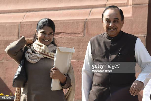 DMK leader Kanimozhi with BJP leader Subramanian Swamy after the presentation of General Budget 2017 on February 1 2017 in New Delhi India In the...