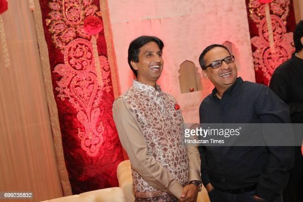AAP leader Kumar Vishwas Cvoter Founder Editor Yashwant Deshmukh during the wedding reception of Ishani Sharma and Sachin Sharma on June 20 2017 in...