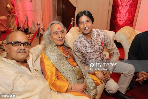 AAP leader Kumar Vishwas with classical singer Channulal Mishra during the wedding reception of Ishani Sharma and Sachin Sharma on June 20 2017 in...