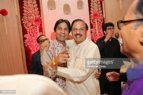 AAP leader Kumar Vishwas with Union Minister Mahesh Sharma during the wedding reception of Ishani Sharma and Sachin Sharma on June 20 2017 in New...