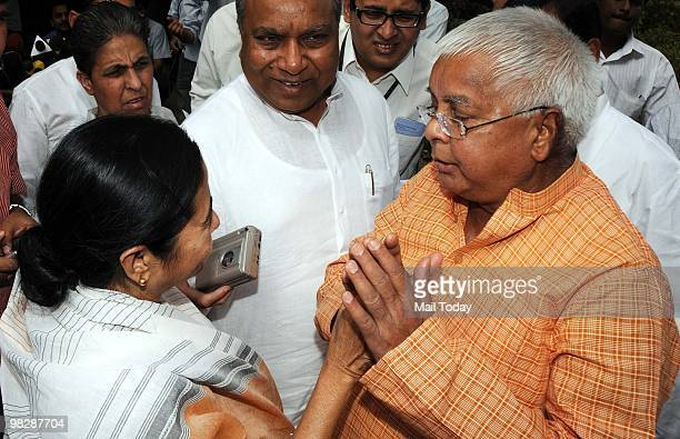 RJD leader Lalu Prasad Yadav interacting with Railway Minister Trinamool Congress chief Mamata Banerjee after attending All Party Meeting on Women...