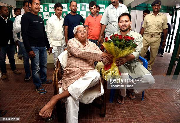RJD leader Lalu Prasad Yadav with son Tejashwi Yadav meets his supporters at his residence after the landslide victory of the grand alliance in Bihar...