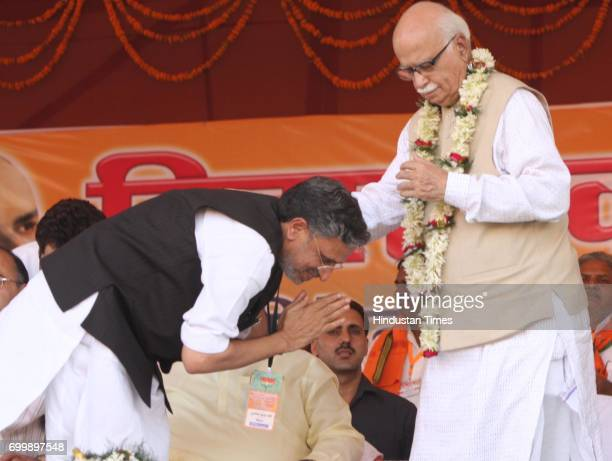 Leader LK Advani being received by Dy Chief Minister Of Bihar Sushil Modi at the Bihar Swabhiman Rally at Gandhi Maidan in Patna