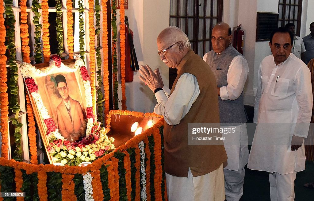 BJP leader L K Advani, Home Minister Rajnath Singh and party MP Subramanium Swami paying tribute to right-wing ideologue Veer Savarkar on his 133 birth anniversary, at Central Hall of Parliament House, on May 28, 2016 in New Delhi, India. Born on May 28, 1883 in Nashik in Maharashtra, Vinayak Damodar Savarkar, later known as Swatantraveer Savarkar, was a revolutionary and Hindu nationalist who was imprisoned by the British in the Cellular Jail in Andaman and Nicobar Islands.