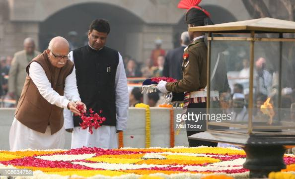 Leader LK Advani scatters rose petals at the Mahatma Gandhi memorial on Gandhi's 63rd death anniversary at Rajghat in New Delhi January 30 2011