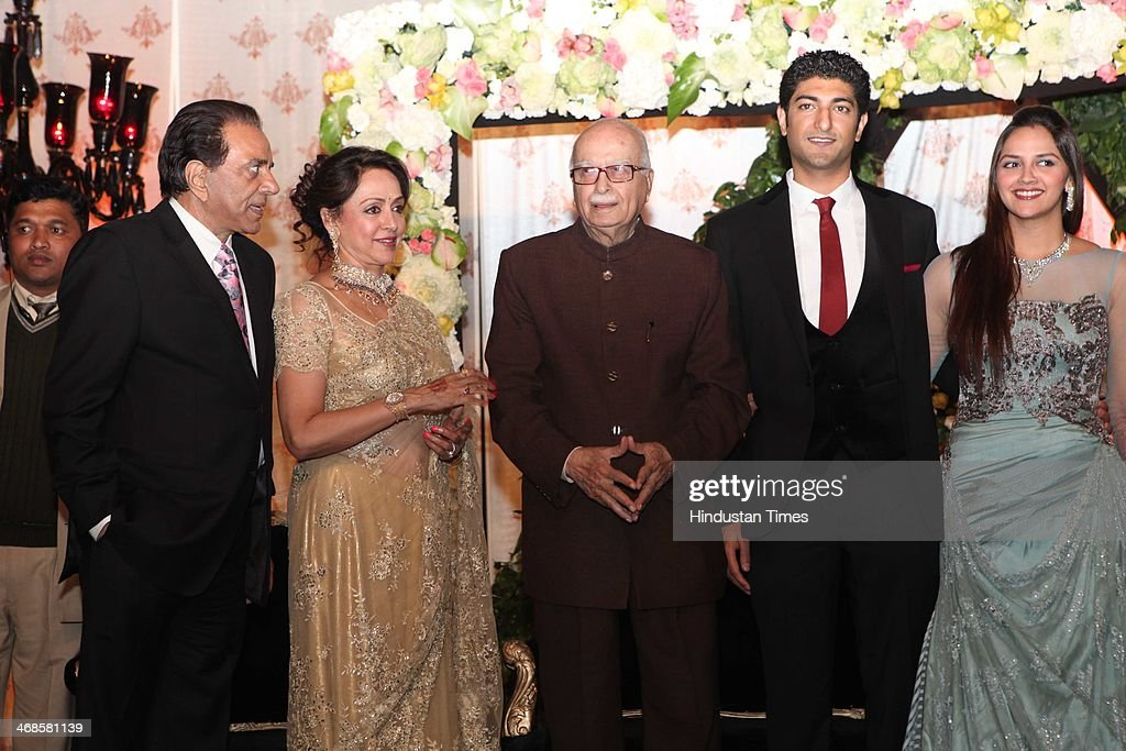 BJP leader LK Advani (C) with Bollywood actors Dharmendra and Hema Malini, their daughter Ahana Deol and son-in-law Vaibhav Vohra during their wedding reception on February 5, 2014 in New Delhi, India. Ahana, a budding Odissi dancer, is the daughter of Bollywood stars Dharmendra and Hema Malini while Vaibhav in an Indian businessman. They married on February 2, 2014 in Mumbai.