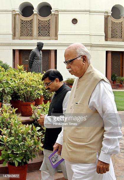 Leader LK Advani with Tarun Vijay after paying tribute to Shyama Prasad Mukherjee on his 111th birth anniversary at Parliament house on July 6 2012...