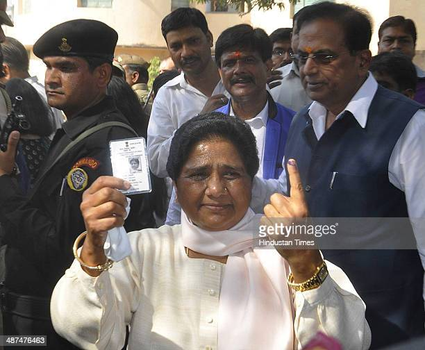 BSP leader Mayawati shows ink stained finger after casting her vote at a polling station for Lok Sabha elections on April 30 2014 in Lucknow India In...