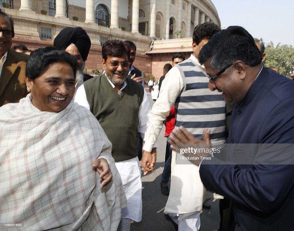 BSP Leader Mayawati with BJP Leader Ravi Shankar Prasad, at Parliament House on the first day of its winter session on November 22, 2012 in New Delhi, India. Parliament's winter session began on a stormy note as the issue of FDI in trade and reservation for ST/SC in promotion disrupted the Lok Sabha and Rajya Sabha.