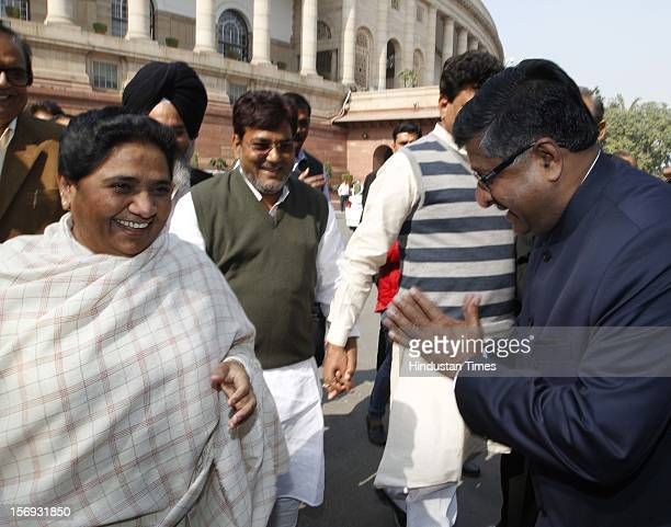 Leader Mayawati with BJP Leader Ravi Shankar Prasad at Parliament House on the first day of its winter session on November 22 2012 in New Delhi India...