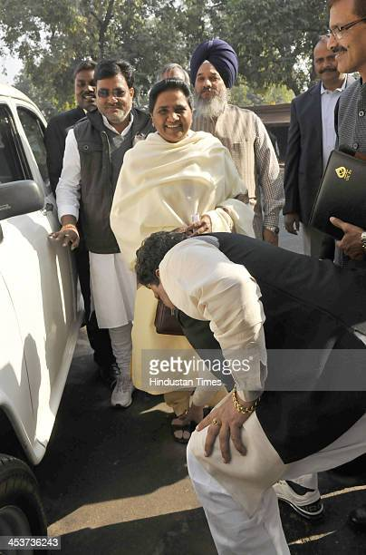 Leader Mayawati with her party leaders at the Parliament House during the opening of the Winter session of Parliament on December 5 2013 in New Delhi...