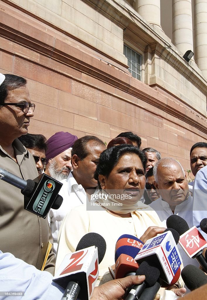 BSP Leader Mayawati with her party MPs at Parliament house for ongoing Budget Session on March 22, 2013 in New Delhi, India. The Lok Sabha failed to transact any business for the third consecutive day as proceedings remained paralysed over the Sri Lankan Tamils issue.