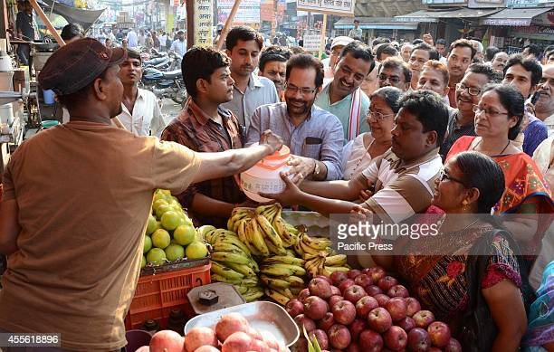 BJP leader Mukhtar Abbas Naqvi along with BJP phulpur MP Keshav Prasad Maurya and party workers soliciting money for Kashmir flood affected people in...