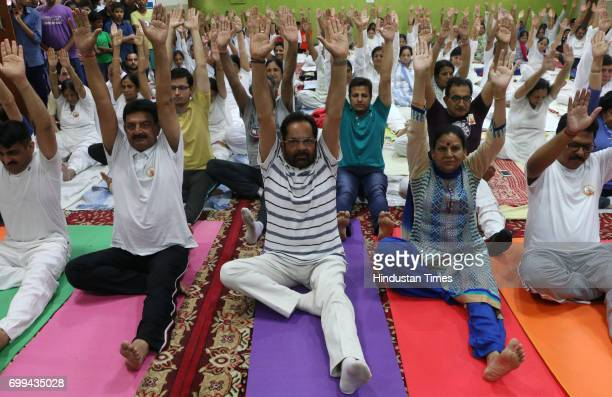 BJP leader Mukhtar Abbas Naqvi participates in Yoga at Noida sector 50 on International Yoga Day on June 21 2017 in Noida India