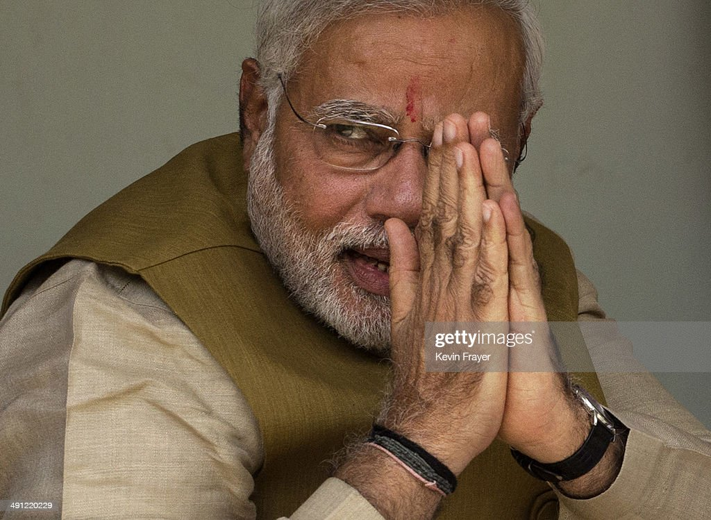 BJP leader <a gi-track='captionPersonalityLinkClicked' href=/galleries/search?phrase=Narendra+Modi&family=editorial&specificpeople=822611 ng-click='$event.stopPropagation()'>Narendra Modi</a> gestures to supporters as he sits with his mother Heeraben Modi, not seen, on her front porch after seeking her blessing on May 16, 2014 in Ahmedabad, India. Early indications from the Indian election results show Mr Modi's Bharatiya Janata Party was ahead in 277 of India's 543 constituencies where over 550 million votes were made, making it the largest election in history.