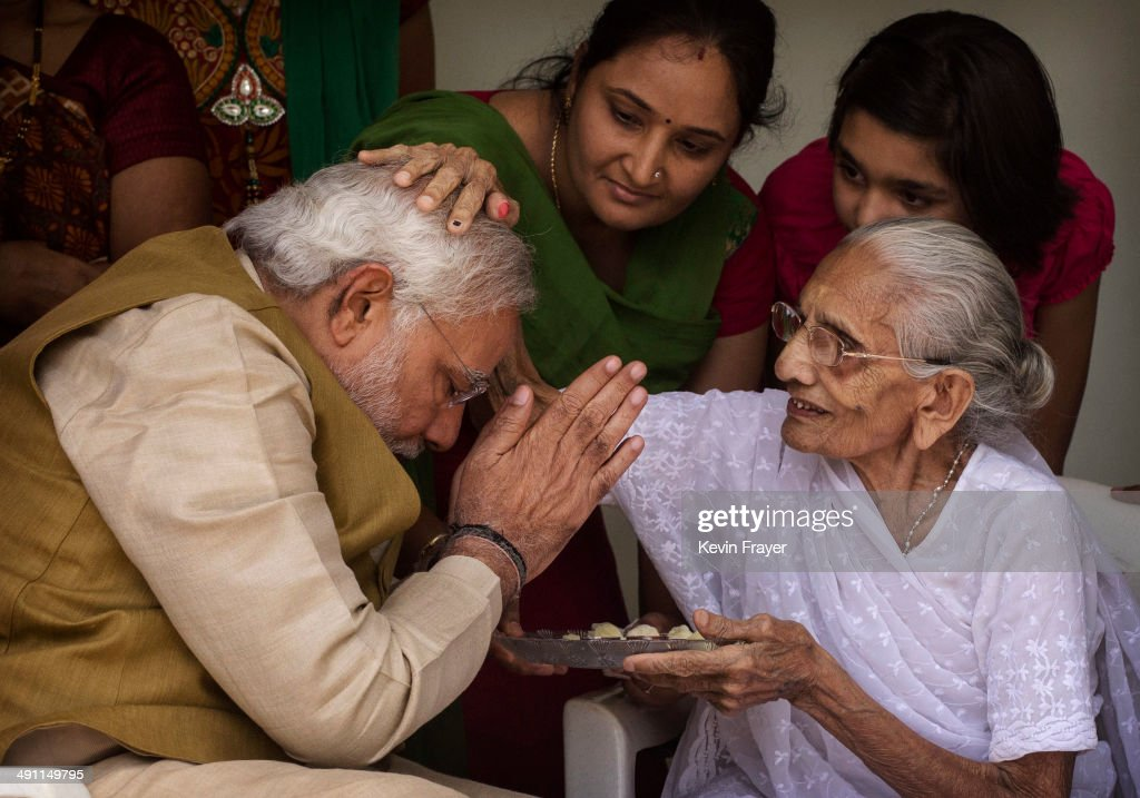 BJP leader Narendra Modi (L) is blessed by his mother Heeraben Modi on her front porch after seeking her blessing on May 16, 2014 in Ahmedabad, India. Early indications from the Indian election results show Mr Modi's Bharatiya Janata Party was ahead in 277 of India's 543 constituencies where over 550 million votes were made, making it the largest election in history.