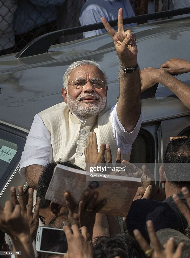 BJP leader Narendra Modi shows his inked finger to supporters as he leaves a polling station after voting on April 30, 2014 in Ahmedabad, India. India is in the midst of a nine phase election that began on April 7 and ends May 12.