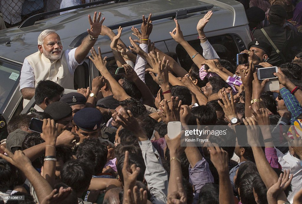 BJP leader <a gi-track='captionPersonalityLinkClicked' href=/galleries/search?phrase=Narendra+Modi&family=editorial&specificpeople=822611 ng-click='$event.stopPropagation()'>Narendra Modi</a> waves to supporters after voting at a polling station on April 30, 2014 in Ahmedabad, India. India is in the midst of a nine-phase election that started on April 7 and ends May 12.