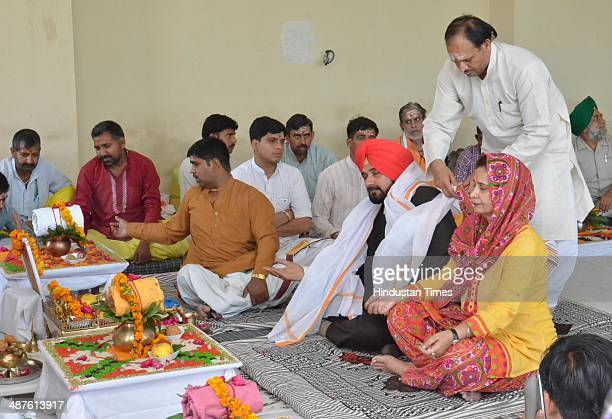 BJP leader Navjot Singh Sidhu along with his wife Dr Navjot Kaur Sidhu member of Punjab Legislative Assembly performing rituals after establishes...
