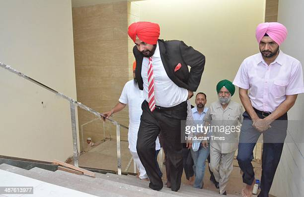 BJP leader Navjot Singh Sidhu offers arrives to establishes the Guru Granth Sahib and Shivling in his new house on May 1 2014 in Amritsar India Sidhu...