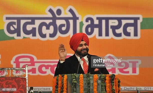 BJP leader Navjot Singh Sidhu speaks during a Public meeting at Dwarka on November 23 2013 in New Delhi India Modi said India has now decided to have...