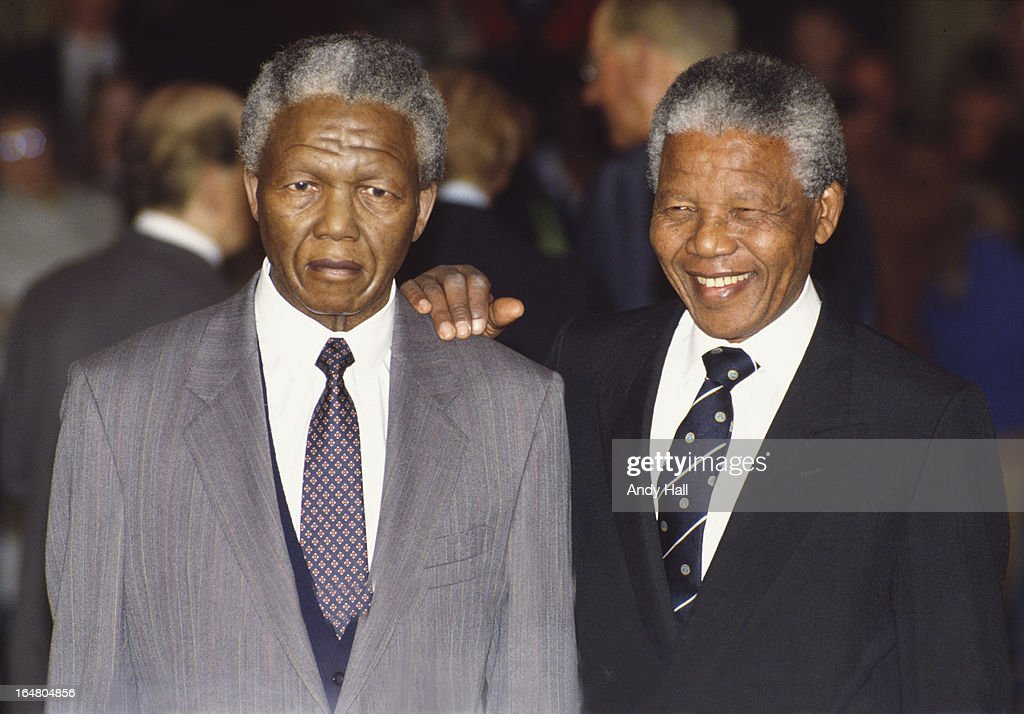 ANC leader Nelson Mandela (right) poses next to his waxwork replica at Madam Tussaud's museum on May 1993 in London,England.