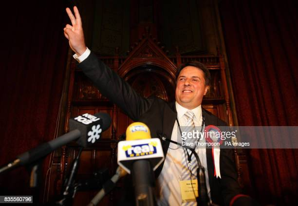 BNP Leader Nick Griffin celebrates after the results of the European Parliamentary Election were announced at Manchester Town Hall