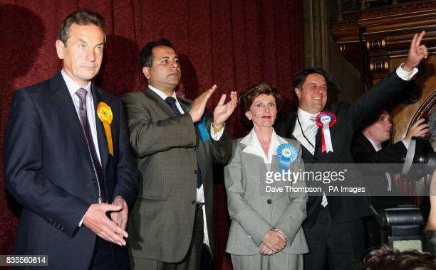 BNP Leader Nick Griffin celebrates standing with other elected MEPs after the results of the European Parliamentary Election were announced at...