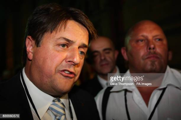 BNP leader Nick Griffin gives a television interview ahead of the European Parliamentary Election results at Manchester Town Hall