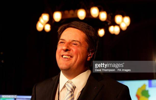 BNP leader Nick Griffin smiles as he gives a television interview ahead of the European Parliamentary Election results at Manchester Town Hall