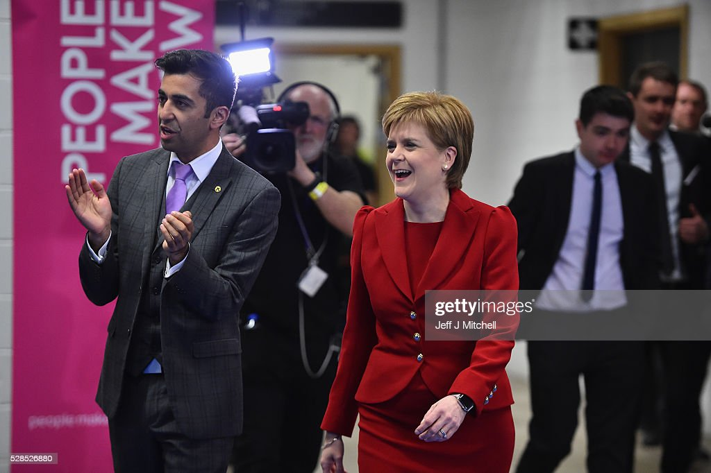 SNP leader Nicola Sturgeon arrives with Humza Yousaf at the count for the Scottish Parliament elections at the Emirates Arena on May 6, 2016 in Glasgow,Scotland. The first declarations are expected at about 02:00 on Friday, with the final result at about 08:00 opinion polls ahead of the vote suggested the SNP was on course to win a third successive victory.