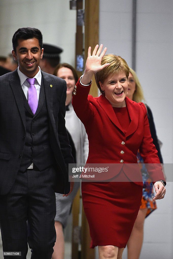 SNP leader <a gi-track='captionPersonalityLinkClicked' href=/galleries/search?phrase=Nicola+Sturgeon&family=editorial&specificpeople=2582617 ng-click='$event.stopPropagation()'>Nicola Sturgeon</a> arrives with Humza Yousaf at the count for the Scottish Parliament elections at the Emirates Arena on May 6, 2016 in Glasgow,Scotland. The first declarations are expected at about 02:00 on Friday, with the final result at about 08:00 opinion polls ahead of the vote suggested the SNP was on course to win a third successive victory.