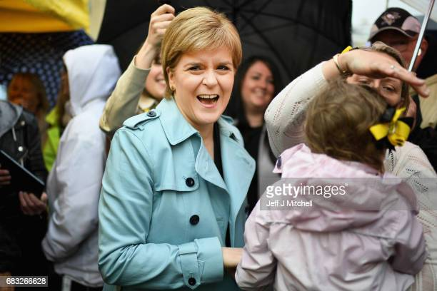 SNP leader Nicola Sturgeon campaigns in Hamilton with candidate Angela Crawley on May 15 2017 in Hamilton Scotland The First Minister will say that...