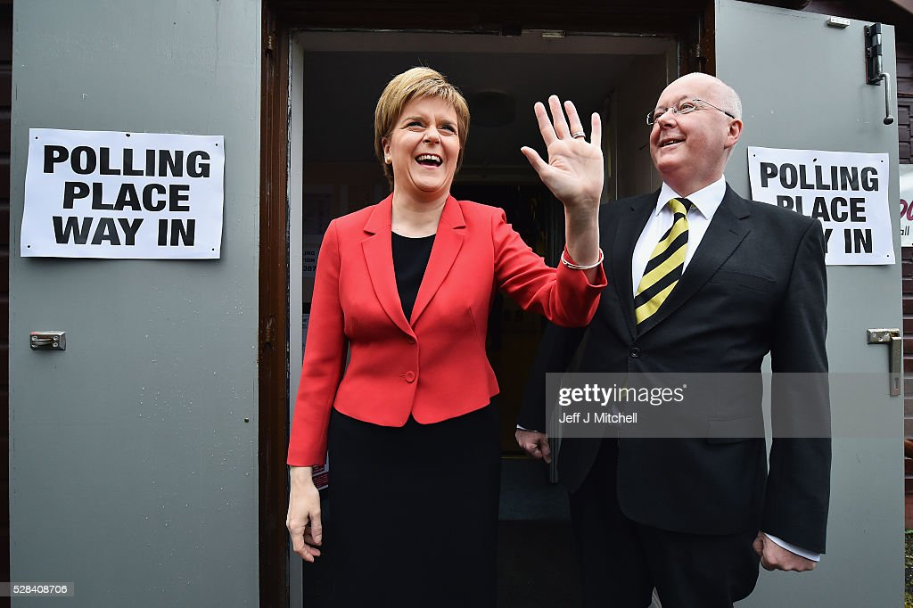 SNP Leader <a gi-track='captionPersonalityLinkClicked' href=/galleries/search?phrase=Nicola+Sturgeon&family=editorial&specificpeople=2582617 ng-click='$event.stopPropagation()'>Nicola Sturgeon</a> casts her vote in the Scottish Parliamentary election, with her husband Peter Murrel at Broomhouse Community Hall on May 5, 2016 in Glasgow, Scotland. Today, dubbed 'Super Thursday', sees the British public vote in countrywide elections to choose members for the Scottish Parliament, the Welsh Assembly, the Northern Ireland Assembly, Local Councils, a new London Mayor and Police and Crime Commissioners. There are around 45 million registered voters in the UK and polling stations open from 7am until 10pm.