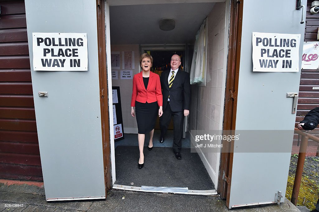 Leader <a gi-track='captionPersonalityLinkClicked' href=/galleries/search?phrase=Nicola+Sturgeon&family=editorial&specificpeople=2582617 ng-click='$event.stopPropagation()'>Nicola Sturgeon</a> casts her vote in the Scottish Parliamentary election, with her husband Peter Murrel at Broomhouse Community Hall on May 5, 2016 in Glasgow, Scotland. Today, dubbed 'Super Thursday', sees the British public vote in countrywide elections to choose members for the Scottish Parliament, the Welsh Assembly, the Northern Ireland Assembly, Local Councils, a new London Mayor and Police and Crime Commissioners. There are around 45 million registered voters in the UK and polling stations open from 7am until 10pm.