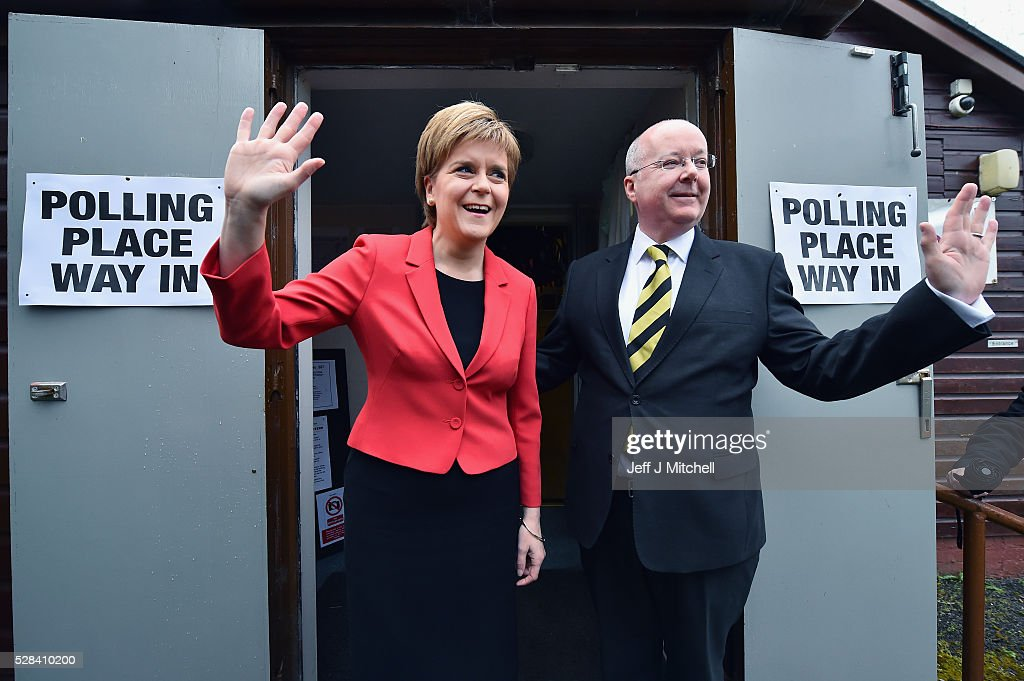 Leader Nicola Sturgeon casts her vote in the Scottish Parliamentary election, with her husband Peter Murrel at Broomhouse Community Hall on May 5, 2016 in Glasgow, Scotland. Today, dubbed 'Super Thursday', sees the British public vote in countrywide elections to choose members for the Scottish Parliament, the Welsh Assembly, the Northern Ireland Assembly, Local Councils, a new London Mayor and Police and Crime Commissioners. There are around 45 million registered voters in the UK and polling stations open from 7am until 10pm.