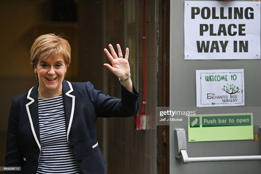 Leader Nicola Sturgeon exits after casting her vote in the general election with her husband Peter Murrel at Broomhouse Community Hall on June 8, 2017 in Glasgow, Scotland.Millions of people across the UK will cast their votes in the 2017 general election.