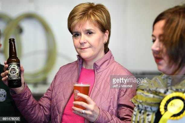 SNP leader Nicola Sturgeon has a pint of beer as she takes a tour of Kelburn Brewery while campaigning for the General Election on June 2 2017 in...
