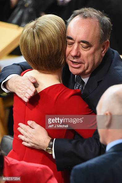 SNP leader Nicola Sturgeon is congratulated by Alex Salmond as she is formally voted in as first minister of Scotland at the Scottish Parliament on...